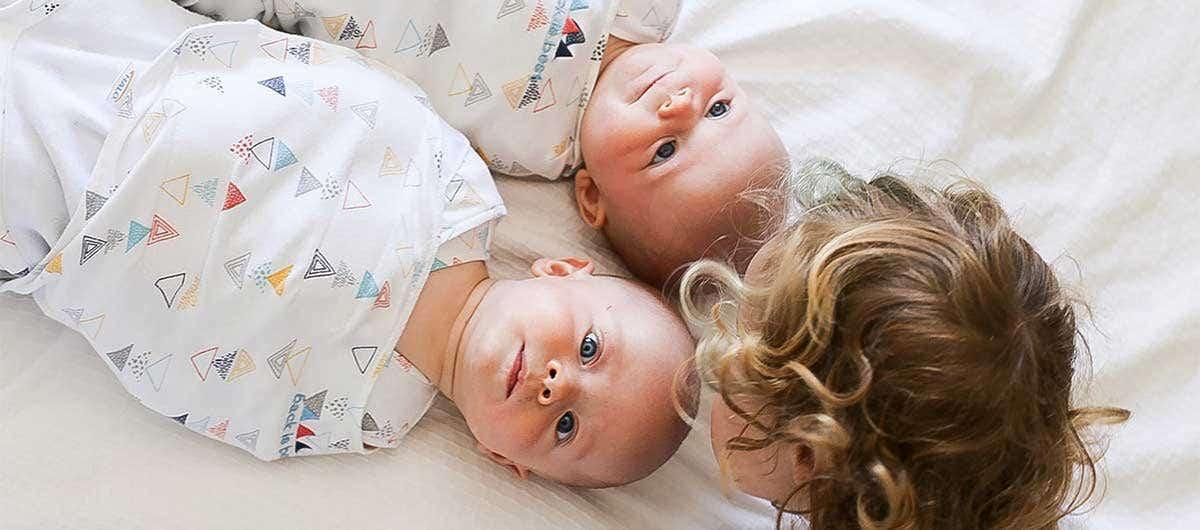 Baby Twins wearing HALO SleepSack Swaddle