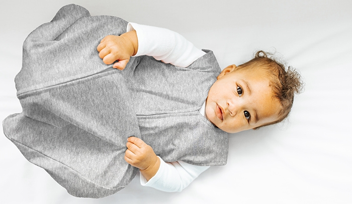 Baby moving his legs while wearing the HALO SleepSack sleeping bag 0.5 TOG Heather Grey