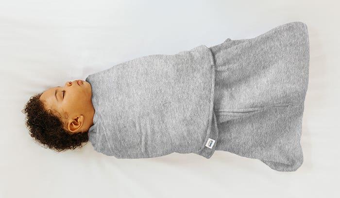 Baby sleeping by wearing HALO SleepSack swaddle 1.5 TOG Heather Grey