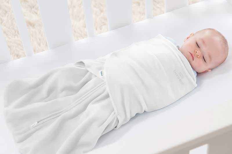 Mum feeding baby who is wearing HALO SleepSack Swaddle White