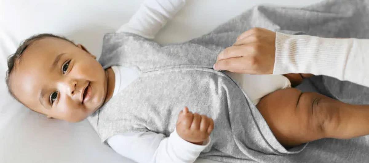 Baby wearing HALO SleepSack Sleeping Bag 0.5 TOG Heather Grey