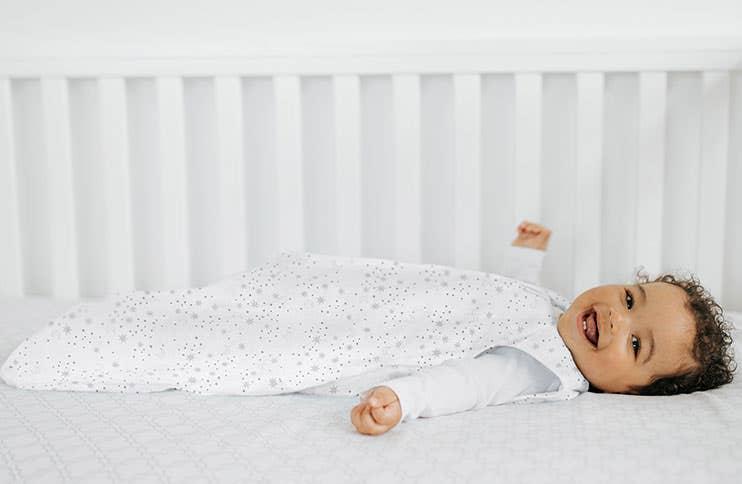 Baby wearing HALO SleepSack sleeping bag 0.5 TOG Midnight Moons