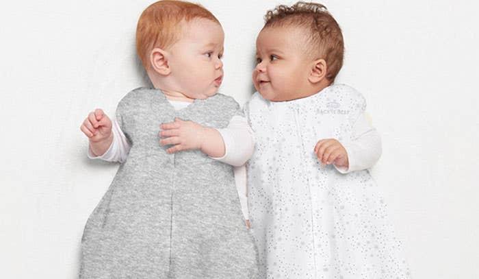 Babies wearing HALO SleepSack sleeping bag 0.5 TOG Midnight Moons and Heather Grey