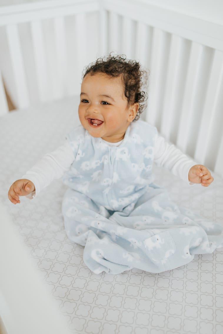 baby in crib wearing halo wearable blanket