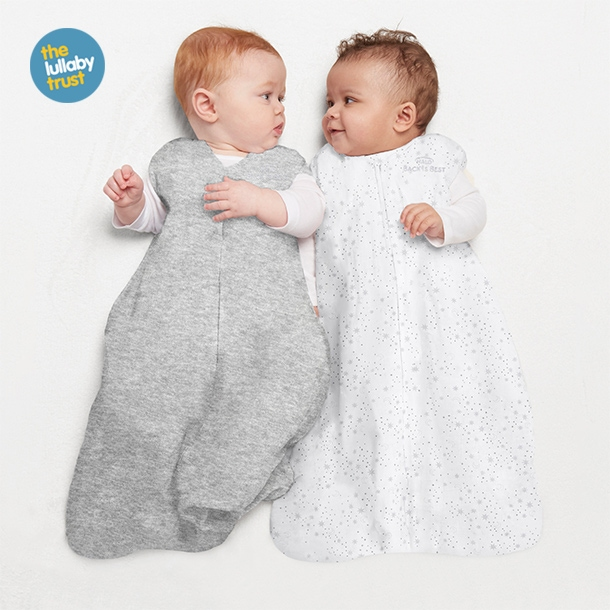 Two babies wearing HALO SleepSack sleeping bag 0.5 TOG Midnight Moons and Heather Grey